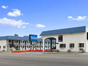 hotel management company Utah - Travelodge Logan, currently Econo Lodge Inn & Suites